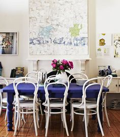 Paint the dinning table a feature colour.. just do it.. dont be scared - it didn't cost any thing just try it... go on do it.. (pic from  real living australia)