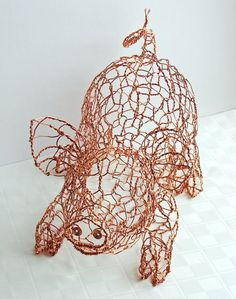 I will buy this for my brother for his odd pig obsession- Twisting Wire to Create Cute Animal Sculptures by Ruth Jensen