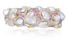 An attractive cultured pearl, coloured sapphire and diamond bangle, by Andre Marcha.