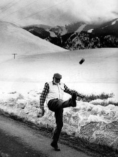 Ernest Hemingway kicks a can, 1959. I can tell this was taken in Sun Valley, ID - Bald Mtn is in the background. Today there is actually a memorial to Hemingway on the same road he's walking on in this photo.