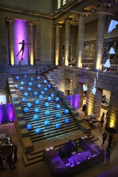 Blue paper lanterns and blue lighting gave the illusion the balls were cascading down the stairs and river effect at the Philadelphia Art Museum {Design: TableArt | Lighting: Eventions Productions}