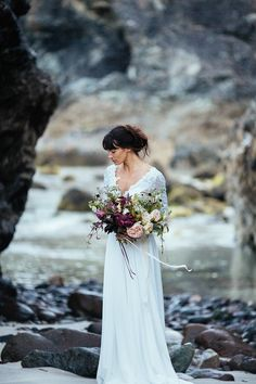 Pared back 'beach bride' elegance at Kynance Cove in Cornwall, with dresses by Maria Senvo. Styled and photographed by Sarah Falugo.