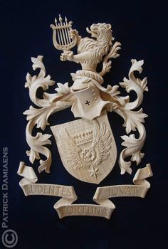 Wooden carving of family Coat of arms & crests Wood Plaques, Family Crest, Crests, Coat Of Arms, Hand Carved, Carved Wood, Wood Carving, Wood Art, Lion Sculpture