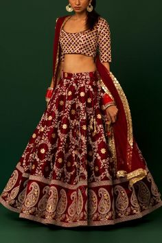 Burgandy Lucknowi Gotapatti Lehenga Price: INR 8290 Take a regal route at the next wedding you attend in this vintage rawsilk burgandy lehenga with the timeless embroidery! Indian Wedding Gowns, Indian Bridal Lehenga, Indian Bridal Outfits, Indian Designer Outfits, Indian Dresses, Designer Dresses, Designer Sarees, Wedding Dress, Half Saree Lehenga