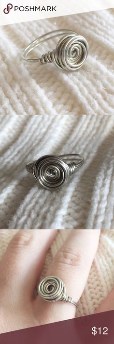 Gorgeous handmade rosette silver wire ring Handmade by me, this ring is simple and beautiful. Pretty and minimalistic. Made with 20 gauge wire and available in all sizes. As with all handmade items, some imperfections may be present. Melody Design Jewelry Rings