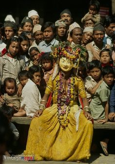 Vintage Nepal ~ Rare Old Pictures, Videos and Arts of Nepal      Group of men and children watching religious street dance in Kathmandu. | Date Photographed: 1980s