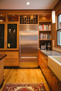 chalkboard cabinets, bookshelves, open storage for kitchenaid, wine rack above fridge