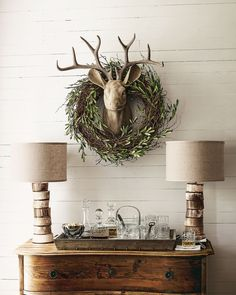 beatiful white planked wall with deer head and rustic green wreath for Christmas www.hickoryhillhome.com