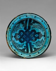 12th c. Raqqa, Syria bowl with Alif-lam Motif, stonepaste polychrome painted uner transparent glaze (dia. 10 3/8 x H 3 in.) - Met Museum 34.71