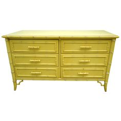 View this item and discover similar for sale at - This Hollywood Regency Faux Bamboo Dresser with 6 drawers features a white faux bamboo trim with chinese chippendale trim brackets at the base.