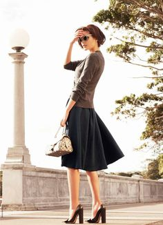 Nice modest outfit. I wish i could find a skirt like this. skirt, sweater, bag, glasses, hair, shoes. All good.