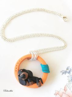 Lazy dachshund necklacepolymer clayfimodachshundorange
