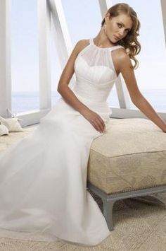 Train: Brush  Embellishment: None  Materials: Chiffon  Neckline: Halter    A line wedding dress, the unique neck design makes this dress a stunning look. The straps go throuth the wrap of the front top and fix ed on the back top hem. The inner layer dress has sweetheart neck.