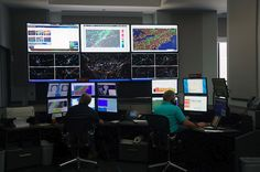Meteroilogists works a large panel of monitors at the new United Airlines Network Operations Center in Chicago. Photo from Chicago by Chris Sloan.