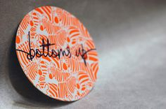 "Letterpressed Neon Coasters - ""Bottoms up"", $16.00"