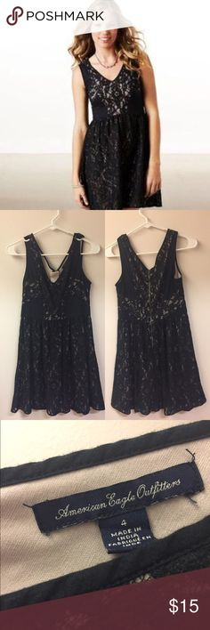 American Eagle Lace Dress Black dress with lace lining on an off-white shell. I've NEVER worn this out even though it's a great LBD (no one invites me to parties) so if you want this, please do the dress the justice of going out on the town for a change. American Eagle Outfitters Dresses Mini