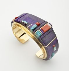 Cuff Bracelet | Charles Loloma. 18 k gold inlaid with sugilite, coral, Lone Mountain turquoise and gold accents. ca. 1980s