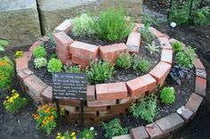 An Herb Spiral is a simple way to improve your kitchen garden. Spiral of rocks, bricks or what have you encloses soil where many kinds of herbs are planted. It is an easy way to accommodate herbs t… Herb Spiral, Spiral Garden, Brick Garden, Garden Path, Garden Club, Garden Beds, Container Gardening, Gardening Tips, Types Of Herbs