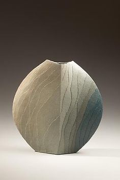 Miyashita Zenji (b. 1939)  Flat rounded stoneware vessel with bandings of colored clay in tones of green to pink, 2010  Stoneware with colored clay  13 x 12 3/4 x 2 3/4 inches