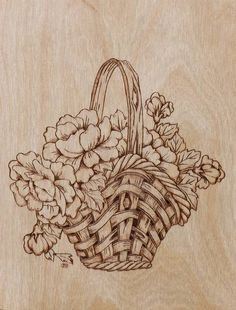 cesto con flores pirograbado