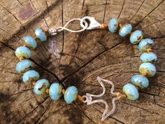 Delicate hammered sterling silver dove link bracelet, sky blue premium czech glass beads, sterling silver clasp, accents