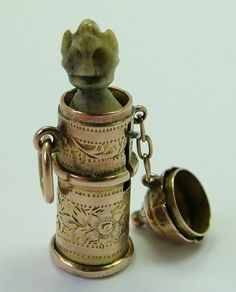 A Victorian 9ct gold temperance charm with a pop up bone Devil.