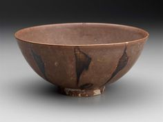Bowl Vietnam, Tran dynasty, 13th–14th century Stoneware with re-brown glaze, painted brown decoration, chocolate brown wash on base, 7.3 x 16.8 cm Museum of Fine Arts, Boston, 1991.994