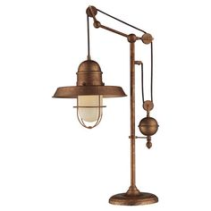 Cast a warm glow in your foyer or den with this eye-catching table lamp, featuring an oiled bronze finish for eye-catching appeal.  ...