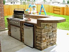 Outdoor kitchen idea. Small size. Raised, rounded social bar/corner. Little fridge. Needs pizza oven or Big Green Egg?