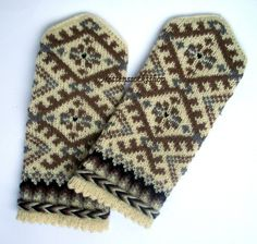 Hand knitted mittens. Warm wool winter mittens. Brown and gray floral ornament on a white background. Christmas gift idea. White, grey,brown
