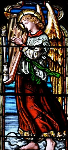 This beautiful harp playing angel is in a stained glass window in St Mary's Church in Reepham, Norfolk.