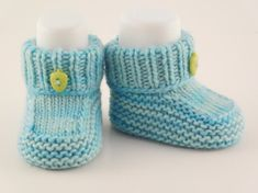 This adorable newborn baby booties is made with 100% merino wool. They are hand knitted using the softest wool in blue and embellished with cute tiny buttons in a co-ordinating colour. These baby booties feature a stay-on design. A must have wardrobe piece to keep those tiny