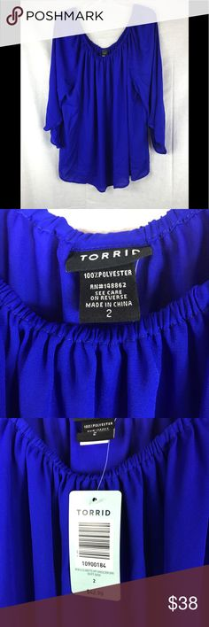Torrid NWT Blouse This NWT Blouse is the most beautiful vibrant blue. Great paired with a mini skirt for a night out a pencil skirt for the office or jeans for casual Friday! torrid Tops
