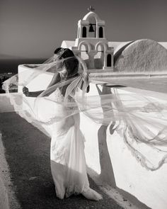 Lindsay wearing a dress during a windy wedding day. Santorini Wedding, Mykonos, Wedding Day, Wedding Photography, Artwork, How To Wear, Instagram, Dresses, Pi Day Wedding
