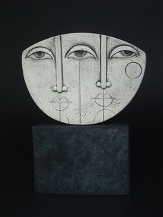 Ceramics by Sue Hanna at Studiopottery.co.uk - Mounted stoneware 2 face mask. Proudced in 2006.