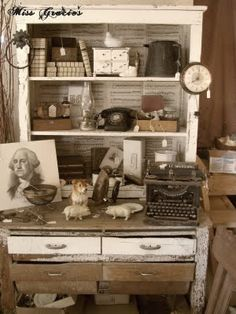 We love Shabby Chic and we love this piece not to mention the old telephone and the old typewriter.... miss gracie's house www.dirtygirlfarm.com