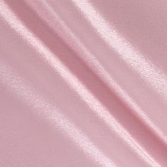Poly Crepe Back Satin Pink from @fabricdotcom  Crepe Back Satin is a reversible satin fabric with a crepe side and a satin side. It's perfect for creating contrasting elements in formal wear, special occasion garments, and bridal gowns.