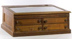 Lot 133: J&P Coats Cotton Oak Spool Cabinet; Having a hinged glass top and four pullout drawers