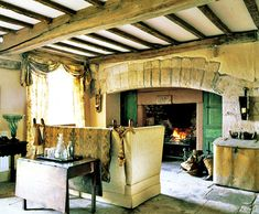 Tim Beddow , knole sofa, English cottage, exposed beam ceiling