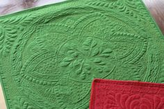 Green:Red Quilts008 by Lori Kennedy of Inbox Jaunt.  Started with a stencil, then embellished with additional FMQ detail