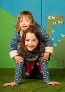 Natty, the little girl who is a model and has Downs Syndrome, shows off her latest fashion shoot with big sister Mia...