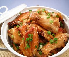 Slow cooker Polynesian glazed chicken wings.Delicious chicken wings with soy sauce and spices cooked in slow cooker.