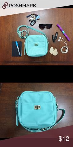 FOREVER21 MINT LEATHER SATCHEL PURSE Mint green colored faux leather purse with cross body strap. Perfect for those nights out when you don't want to drag around a large purse. Cute color will stand out and make you the center of attention.  Inside contains 2 pockets on either side. One has a zipper closure and the other does not. One extra pocket on the outside front.   Length: 7 inches Height: 7 inches  Depth: 3.5 inches  Outer Shell: 100% Polyurethane  Inner Shell: 100% Polyester  NWOT…