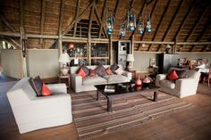 An open air comfy lounge to sit around in before game drives and dinner. Okavango Delta, Game Reserve, Luxury Travel, Places Ive Been, Lounge, Comfy, Camping, Furniture, Dinner
