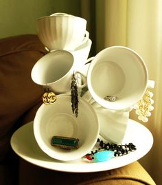 23 Jewelry Display DIYs! | Sincerely Yours. I like the tipsy cups, and the lace picture frame for hanging earrings.