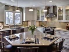 Different island... love the subtle subway backsplash and cabinet heights