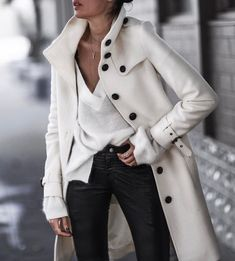 Pretty long white coat with black jeans..