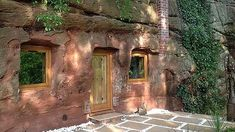 Angelo Mastropietro converted an abandoned cave into a luxury hobbit-hole retreat in the UK. Luxury Homes Dream Houses, Green Building, Building Design, Patio, House Styles, Modern, Outdoor, Hobbit Hole, Snow Man