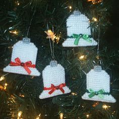 Hand-Crafted Plastic Canvas Holiday Ornaments You are viewing a 2 piece set of Christmas bells hand made for the holiday. These pretty ornaments are crafted using plastic canvas & Red Heart yarn in holiday colors. Ornaments are double-sided and feature satin ribbon and pearls.
