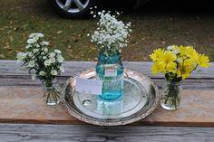 silver platter under mason jars in centerpiece